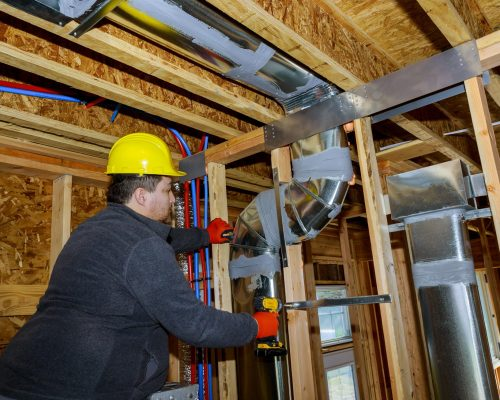workers-making-final-air-duct-conditioning-hvac-sy-MF4ZMR2-min